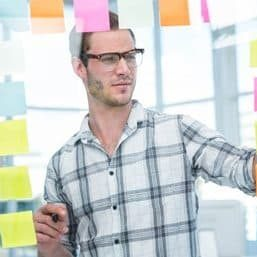 Hipster man looking at post-it